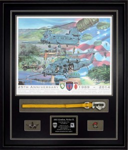 Example of a military shadow box with an object hand sewn, a commemorative military print, and ranger mementos