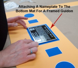 Attaching A Nameplate To The Bottom Mat For A Framed Guidon
