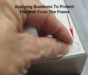 Example showing the application of bumpons to the back of a frame on the dust cover.