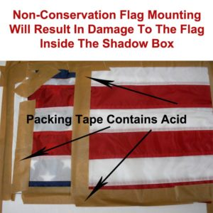 Flag Taped With Packing Tape For Framing Inside A shadow Box Demonstrates A Non-Conservation Method of Custom Framing